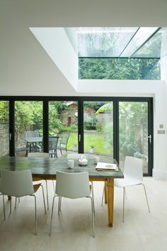 The Growing Popularity of Glass Kitchen Tables Most people prefer glass kitchen table, as it demands low maintenance as compared to the wooden kitchen tables. Different shapes of glass kitchen tabl Glass Kitchen Tables, Door Alternatives, Ideas Geniales, Folding Doors, House Extensions, New Room, Home Renovation, Architecture, Kitchen Design