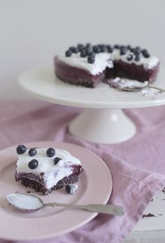 raw blueberry cake with whipped coconut cream