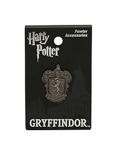 """Gryffindor is the house which most values the virtues of courage, bravery and determination. If you're a Gryffindor, you'll want this small pewter pin from <i>Harry Potter</i> featuring an elegant Gryffindor crest design. Can also be worn as charm.<br><ul><li style=""""list-style-position: inside !important; list-style-type: disc !important"""">Approx. 1""""</li><li style=""""list-style-position: inside !important; list-style-type: disc !important"""">Alloy</li><li style=""""list-style-position: inside…"""