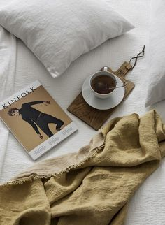Cozy bed setting with tea in bed, soft linen blanket and Kinfolk magazine | Image by Erik Lefvander for Hanna Wessman via Residence