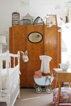I'm not interested in the nursery aspect of this room; I love the wardrobe and the birdcages on top.