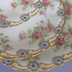Antique Limoges embossed flowers and gold.  Frilly and pretty.