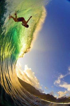 Going down! Parker Coffin dropping in at Teahupo'o. Shot using SPL water housing + CanonMarkIV+ Fisheye lens. For more photos check out www.ZAKNOYLE.com