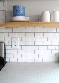 "Pretty much exactly what I'm planning - counters & backsplash. For the backsplash I went classic with a simple x subway tile. I used American Olean White Mosaic Subway Wall tiles with ""Pewter"" grout also available through Lowe's here. Home Kitchens, Kitchen Remodel, Subway Tile Backsplash Kitchen, Kitchen Countertops, Kitchen Tiles Backsplash, White Subway Tiles, White Worktop, White Subway Tile Kitchen, Trendy Kitchen"