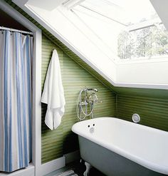 Tucking the shower under a slanted ceiling, Using a small pedestal sink and placing a large, angled skylight above the tub opens this small bathroom up, expanding the space and providing a blast of natural light and fresh air during the warmer months. myhomeideas.com
