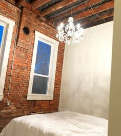this is a old building with a loft apartment from my little historic home town. i love the chandelier and exposed brick. Exposed Brick Bedroom, Brick Wall Bedroom, Brick Room, Exposed Wood, Brick Walls, Loft Spaces, Loft Apartments, Discount Bedroom Furniture, Chandelier Bedroom