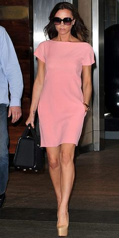 Victoria Beckham  WHAT SHE WORE  Beckham made the fashion rounds in platform Louboutins and a blush pink dress from her own collection.