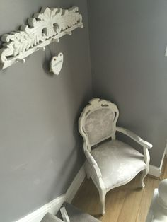 Hallway grey clay paint white accessories. French vintage chair painted in Annie Sloan old white and reupholstered in Laura Ashley dove grey fabric