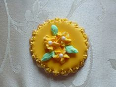 Hand-painted flower medallion sugar cookie in Goldenrod