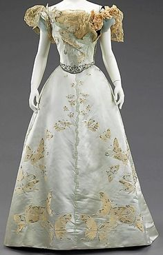 """fashioninhistory: """" Ball Gown House of Worth 1898 This gown is made from a very special fabric which was woven à la disposition to fit the shape and dimensions of the skirt so that the butterflies flutter upward from the hem and, being graduated in... (Front 1)"""