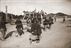 """Chinese Wedding Palanquin On the backside, this ca. 1904 amateur photograph is labeled with """"Chinese Wedding Palanquin"""". From a german machinist who worked on a pilot boat of the port authority of Qingdao."""