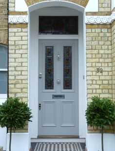 Looking to paint your front door a different color? These designers reveal their favorite front door colors. Victorian Front Doors, Grey Front Doors, Front Door Porch, Front Doors With Windows, House Front Door, Front Door Colors, Glass Front Door, House Doors, Victorian Homes