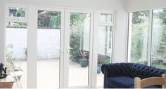 These are French Doors designed for a home in #Dublin. French doors in the centre with windows at either sides.