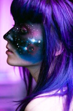 Girl with purple hair & face painted with outer space art