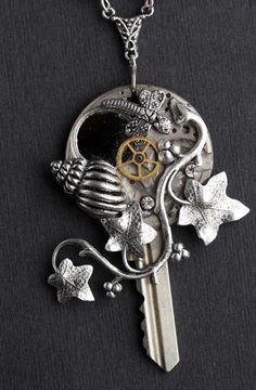 Steampunk key, clockwork, ivy, and shell necklace. Going to make myself one.