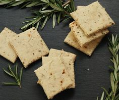 Paleo Herb Crackers    Print Recipe    2 cups almond flour    1/2 teaspoon sea salt    2 tablespoon favrite herbs of choice (I used a blend of pizza seasoning and rosemary)    2 tablespoons water    1 egg white    1 tablespoon olive oil    1/4 teaspoon coconut oil