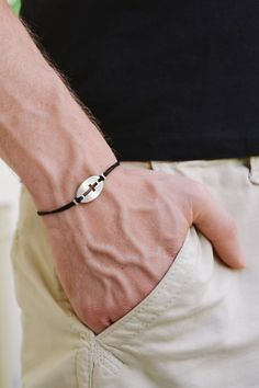 Cross bracelet for men - cord bracelet with a antique silver cross round charm. The cords are black and made of waxed cotton and the charm is s zinc alloy metal. Closure: clasp. You can request a different cord color from the colors shown in the last picture. The bracelet is 7 1/2 inch