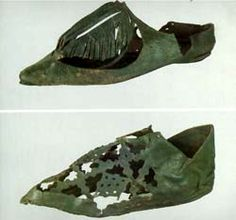 Leather shoes with cut-out ornament. 14th century
