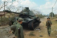 Vietnam War 1968 - South Vietnamese Troops Passing Dead Body on Tank Vietnam History, Vietnam War Photos, American War, American History, Brown Water Navy, Patton Tank, Italian Army, North Vietnam, Armored Fighting Vehicle