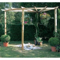 The Hartwood Radial Pergola will create an interesting and vibrant focal point for your garden. Ideal for placing on a patio to create your ideal outdoor entertaining area. The pergola covers a quarter circle based on a radius of Manufactu Wooden Pergola Kits, Timber Pergola, Pergola With Roof, Covered Pergola, Patio Roof, Patio Grill, Modern Pergola, Garden Pavilion, Pergola Garden