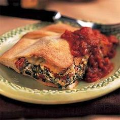 Spinach Calazomes.....Pack in the calcium with this great-tasting spinach calzone recipe. It's easy to make, and you only need a salad to complete the meal.