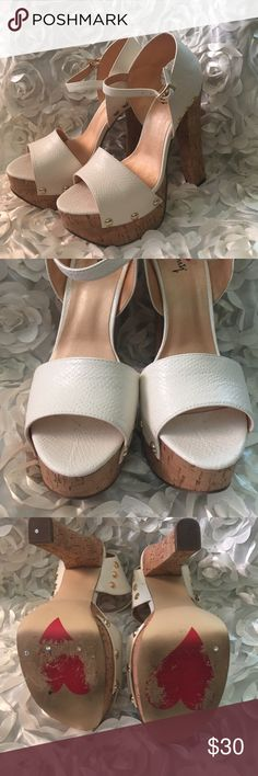 """White clogs Absolutely must to add to your jeans! Beautiful and super comfortable white heeled clogs. Been worn, twice so are no damaged. Little marks on the inside part (see pictures) not visible when wearing. Heel approx 6"""" with 2"""" platform Shoes Heels"""