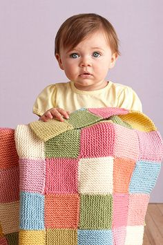 Colorful knit, patchwork baby blanket.