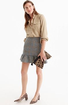 This flirty above-the-knee skirt with a ruffly hem and a menswear pattern pairs perfectly with your favorite fall footwear.