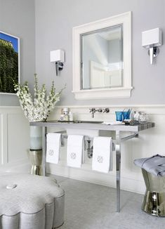 Especially love the scalloped ottoman, the elegant chrome vanity, and the mirrored stool/side table.