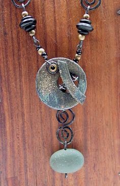 Here is the Poly stone necklace w/ a beautiful handmade clay toggle.