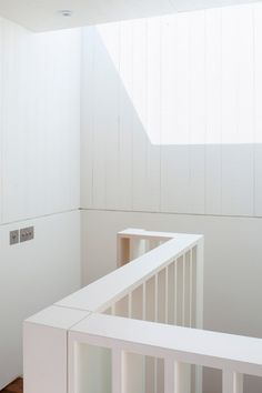 West Heath loft conversion with a secret room by Milford Martin Architects