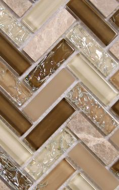 Can't get enough of this brown herringbone backsplash tile | Neutral tones of cracked glass, natural stone and smooth glass | Archery Wedgwood herringbone mosaic glass tile will create a stunning kitchen backsplash