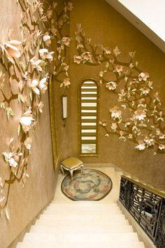 Paper flower installation created by Jo Lynn Alcorn for Maya Romanoff Wallpapers at Kips Bay Decorator Show House 2009.  Such wonderful whimsy and tactile materials to create a stunning wall treatment thats unique and one of a kind!