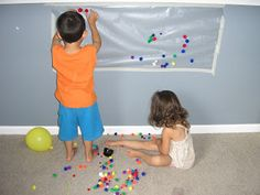 Sticky Wall!  Just tape some clear contact paper to the wall or window, sticky side facing you. Then let the kiddies experiment with sticking different items - small blocks, pompoms, macaroni, the ideas are limitless. Can also be done with a themed shape as well - Christmas tree with decorations, Easter Egg, etc. Great sensory activity!