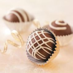 Hint-of-Berry Bonbons Recipe -You'll have a hard time eating just one of these heavenly sweets. Inside the rich milk chocolate coating is a fudgy center with a hint of strawberry. Their white chocolate drizzle makes these bonbons even more special. —Brenda Hoffman, Stanton, Michigan