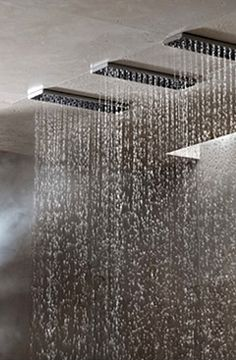 Dornbracht Horizontal shower system _  Love how dramatic this is, like you're in a rainstorm, combine with the large shower window and it could be like you're showering in a torrential downpour outside!
