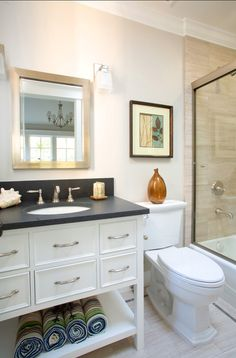 White, small bathroom is stylish and practical;  dimensions: 5'4″ x 9′