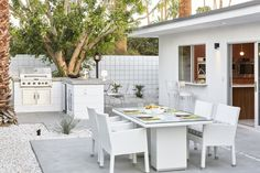 Karbon® bar faucet     An inviting and well-designed outdoor cooking and dining space extends the home beyond its walls.