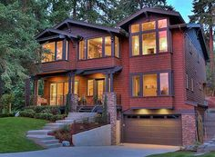 Architectural Designs House Plan 23652JD is designed for a front sloping lot and gives you over 3,700 square feet of living on the main two floors plus a 5th in the optional finished lower level. An elevator serves all three levels. Ready when you are. Where do YOU want to build?