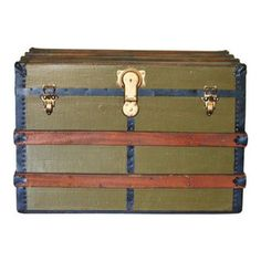 Antique Wooden Olive Green Steamer Trunk - Vintage trunks like this one are perfect for storing blankets in a guest room or using as a side table or nightstand. I dream of someday finding a vintage Louis Vuitton trunk that won't cost more than my mortgage!