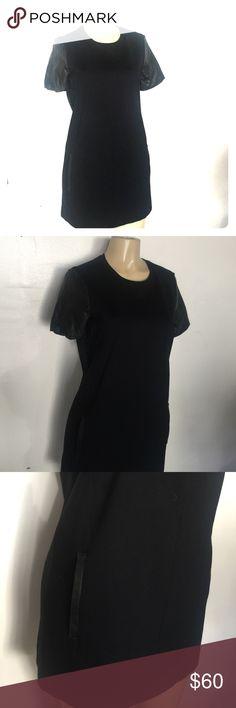 Black Club Monaco mini dress NWOT never worn. Faux leather cap sleeve, faux leather trim in pockets. Adorable A-line fit size 4 Club Monaco Dresses Mini
