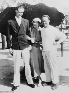 Producer Howard Hughes, left, with Mrs Sailing Baruch and Paramount's executive manager Hal Kauffman in Miami in 1934