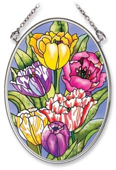 Amia Hand Painted Glass Suncatcher with Tulip Design, 3-1/4-Inch by 4-1/4-Inch Oval by Amia. $11.00. Comes boxed, makes for a great gift. Includes chain. Handpainted glass. Amia glass is a top selling line of handpainted glass decor. Known for tying in rich colors and excellent designs, Amia has a full line of handpainted glass pieces to satisfy your decor needs. Items in the line range from suncatchers, window decor panels, vases, votives and much more.