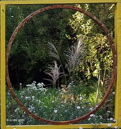 by Er.We A recycled Trampoline hoop -- left to rust -- and roofing laths. Put them together and what do you have? A great garden feature!!