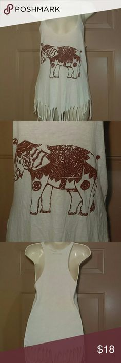 """BRANDY MELVILLE ELEPHANT TOP W/FRINGE-ONE SIZE -Brandy Melville Elephant Tank Top with Fringe -One Size Fits All -Never Worn -White top with brown elephant in front -Slight racetrack style -70% Lana Wool, 30% Viscose -Made in Italy -Armpit to armpit measures 14"""", laying flat -Top of shoulder to bottom hem measures 28"""", including fringe -Fringe measures 4"""" -Super Cute!!! Brandy Melville Tops Tank Tops"""