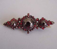 "BOHEMIAN rose cut garnets and garnet cabochon bar brooch, circa 1900, 2""."