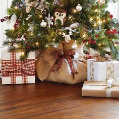 Burlap Tree Skirt - 2 yds burlap, wide red-&-green plaid Christmas ribbon - Open burlap fabric and spread out over floor, Set Christmas tree in center of burlap, Gather sides of burlap, Tie ribbon tightly around tree trunk