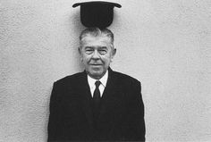 René Magritte being surreal, photographed by Duane Michals.