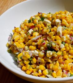 "This corn salad recipe gives grilled corn bold flavor by adding zesty jalapeño, cilantro, and feta. It is a perfect side dish for any barbecue. Apple cider vinegar acts like a ""secret ingredient"" that makes it really memorable. Any type of cooking vinegar can be substituted, like sherry or red wine vinegar. #recipes #salad #corn #jalapeño"