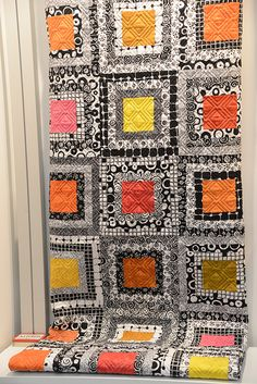 "This bright quilt combines Andover's Night  Day and Tic Tac collections, both by Kim Schaefer. Click on the picture to download this free pattern. These fabrics are available from the Fabric Shack at http://www.fabricshack.com/cgi-bin/Store/store.cgi Just search for ""Night  Day"" and ""Tic Tac"""